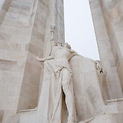 A detail of the center of the twin white pylons  of the Canadian National Vimy Memorial showing the Spirit of Sacrifice. The monument is dedicated to the memory of Canadian Expeditionary Force members killed in World War one. The monument is situated at a 100 hectare preserved battlefield with wartime tunnels, trenches, craters and unexploded munitions. The memorial designed by Walter Seymour Allward opened in 1936.