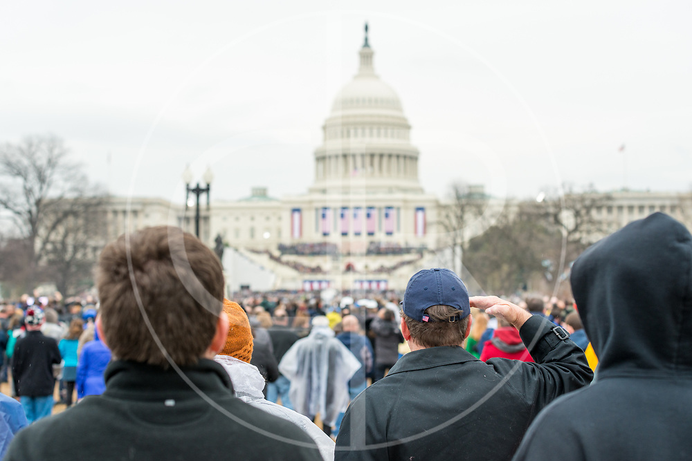 Washington DC, United States - An attendee salutes in the direction of the U.S. Capitol at the conclusion of the 2017 inauguration ceremony for Donald J. Trump.
