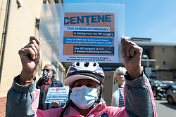 © Licensed to London News Pictures. 22/04/2021. LONDON, UK.  Local residents protest outside Willesden Centre for Health & Care at the takeover of 49 GP practices in England by a US based private health company, Centene, through its UK subsidiary, Operose Health.  Centene has recently taken over AT Medics, a primary care provider responsible for 49 GP surgeries and over 370,000 patients in the Greater London area, including the Burnley practice based at Willesden Centre for Health & Care. Other similar protests are taking place across the capital.  Photo credit: Stephen Chung/LNP