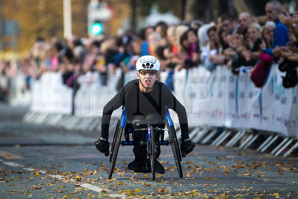 © Licensed to London News Pictures . 15/10/2017 . Manchester , UK . Wheelchair racer ADAM GOLDSPINK-BURGESS reaches the finish line in the Greater Manchester Half Marathon in Old Trafford . Photo credit : Joel Goodman/LNP