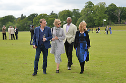 Left to right, PHILLIP GLENISTER, FIONA HAWTHORNE, COLIN SALMON and BETH GODDARD at the Audi Polo Challenge at Coworth Park, Blacknest Road, Ascot, Berkshire on 31st May 2015.