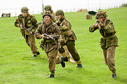 British Paras charge German positions during a Northern World Ward Two Battle reenactment at the Lytham St Annes Battle of Britain Celebration 1940s War Weekend 21 Aug 2010 <br /> Images © Paul David Drabble