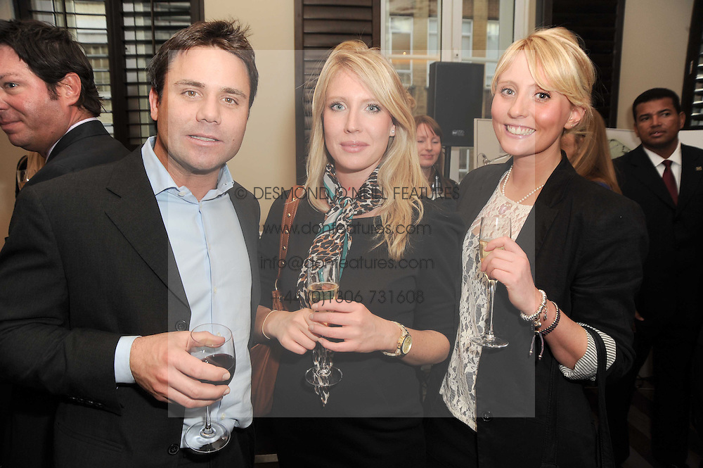 A party to promote the exclusive Puntacana Resort & Club - the Caribbean's Premier Golf & Beach Resort Destination, was held at The Groucho Club, 45 Dean Street London on 12th May 2010.<br /> <br /> Picture shows:-Left to right, MAX GALLAND, LAURA KING and AMY KING