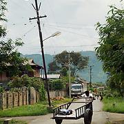 Man pushing cart to market at Nyaungshwe