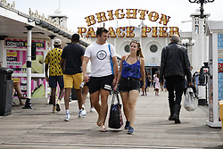 © Licensed to London News Pictures. 23/07/2021. Brighton, UK. People enjoy the warm weather and sunshine on the sea front at Brighton on the south coast. The weather will change for most places tomorrow with rain and lightning forecast. Photo credit: Peter Macdiarmid/LNP