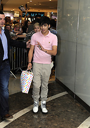 """© Licensed to London News Pictures. 15/09/2011.Lakeside,Essex, UK.One Direction at Lakeside,Essex to sign copies of their new book """"Dare to Dream"""".  Liam, Harry, Zayn, Louis and Niall showed off the new book at   Lakeside's Central Atrium today (15.09.2011).Zayan Malik.Photo credit : Grant Falvey/LNP"""