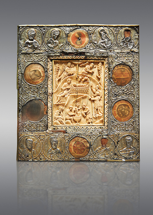 Medieval Christian relief Icon depicting scenes from the Nativity, A central ivory panel surrounded by beaten silver border. From Constantinople, 11th or 12th century. Inv. OA 11399, The Louvre Museum, Paris. .<br /> <br /> If you prefer you can also buy from our ALAMY PHOTO LIBRARY  Collection visit : https://www.alamy.com/portfolio/paul-williams-funkystock/byzantine-art-antiquities.html . Type -    louvre     - into the LOWER SEARCH WITHIN GALLERY box. Refine search by adding background colour, place, museum etc<br /> <br /> Visit our BYZANTINE MOSAIC PHOTO COLLECTION for more   photos  to download or buy as prints https://funkystock.photoshelter.com/gallery-collection/Roman-Byzantine-Art-Artefacts-Antiquities-Historic-Sites-Pictures-Images-of/C0000lW_87AclrOk