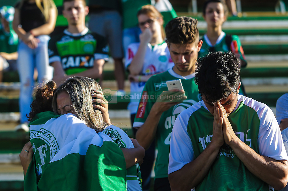 CHAPECO, Nov. 30, 2016 (Xinhua) -- Supporters of Brazilian football team Chapecoense take part in a vigil at Conda Arena in Chapeco municipality, Santa Catarina state, Brazil, on Nov. 29, 2016. Colombian President Juan Manuel Santos on Tuesday lamented the plane crash in the northwest of his country that killed 71 people. The LMI2933 charter flight carrying Brazilian football team Chapecoense was heading to a championship final of the South American Cup in Medellin, Colombia. (Xinhua/AGENCIA ESTADO) (djj) ***BRAZIL OUT* (Credit Image: © Agencia Estado/Xinhua via ZUMA Wire)