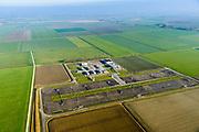 Nederland, Groningen, Gemeente Loppersum, 04-11-2018; Aardgaswinningsinstallatie en gasbehandelingslocatie bij 't Zandt (Het Zandt), midden in het door aardbevingen getroffen gebied, bevingen die het gevolg zijn van de winning van aardgas.<br /> Natural gas extraction facility in earthquake-affected area, quakes resulting from the extraction of natural gas.<br /> <br /> luchtfoto (toeslag op standaard tarieven);<br /> aerial photo (additional fee required);<br /> copyright© foto/photo Siebe Swart