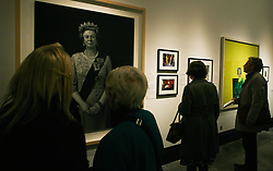 © Licensed to London News Pictures. 16/05/2012. London,Britain.Visitors of the gallery National Portrait Gallery is looking at the portrait  of Queen Elizabeth II by Pietro Annigoni.The exhibition includes formal painted portraits, official photographs, press images and works by contemporary artists exploring the evolution of the Queen's image throughout the 60 years of her reign.Photo credit : Thomas Campean/LNP