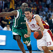 Galatasaray's Ender ARSLAN (R) during their Euroleague Game 2 basketball match Galatasaray between Unics Kazan at the Abdi Ipekci Arena in Istanbul at Turkey on Thursday, October, 27, 2011. Photo by TURKPIX