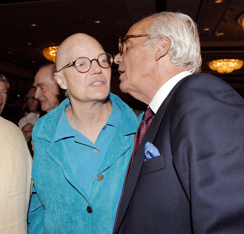Austin, TX October 8, 2006: Molly Ivins gets a kiss from editor emeritus Lewis Lapham of Harper's Magazine at a dinner in her honor. ©Bob Daemmrich/