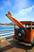 Classic Woody with Surfboards On San Clemente Pier