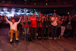 © Licensed to London News Pictures. 07/07/2016. LONDON, UK.  Supporters cheer at a Momentum rally in support of keeping Jeremy Corbyn as the Labour party leader at the Troxy in east London on 6th July 2016. The event was organised by Momentum, a group of Labour Party supporters who are campaigning for Jeremy Corbyn to remain as leader of the Labour Party, following the recent resignation of many shadow cabinet MP's and the growing likelihood of a Labour Party leadership challenge..  Photo credit: Vickie Flores/LNP