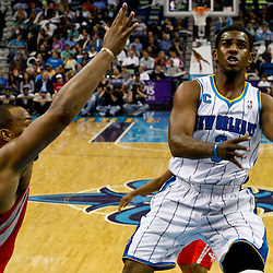 April 6, 2011; New Orleans, LA, USA; New Orleans Hornets point guard Chris Paul (3) shoots over Houston Rockets center Chuck Hayes (44) during the first half at the New Orleans Arena.   Mandatory Credit: Derick E. Hingle-US PRESSWIRE