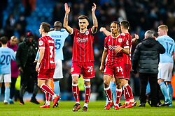 Jamie Paterson of Bristol City thanks the away support after his side lose 2-1 in added time - Rogan/JMP - 09/01/2018 - Etihad Stadium - Manchester, England - Manchester City v Bristol City - Carabao Cup Semi Final First Leg.