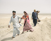 """Pilgrims from the Thar desert circumnavigating one of the volcano. The area around Chandragup (meaning """"Moon Well""""), a sacred site to Hindu of 3 mud volcanoes (mainland Asia's largest ones)."""