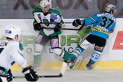 Bostjan Golicic (HDD Tilia Olimpija, #71) vs Aaron McKenzie (EHC Liwest Black Wings, #37) during ice-hockey match between HDD Tilia Olimpija and EHC Liwest Black Wings Linz in 37th Round of EBEL league, on Januar 9, 2011 at Hala Tivoli, Ljubljana, Slovenia. (Photo By Matic Klansek Velej / Sportida.com)