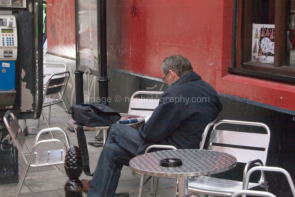 Seats outside a bar in Dublin Ireland. Since the law to exclude smoking from the workplace in Ireland in 2004, many bars and cafes have provided outside seating for customers who smoke.