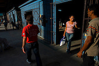 woman exiting grocery in havana, cuba