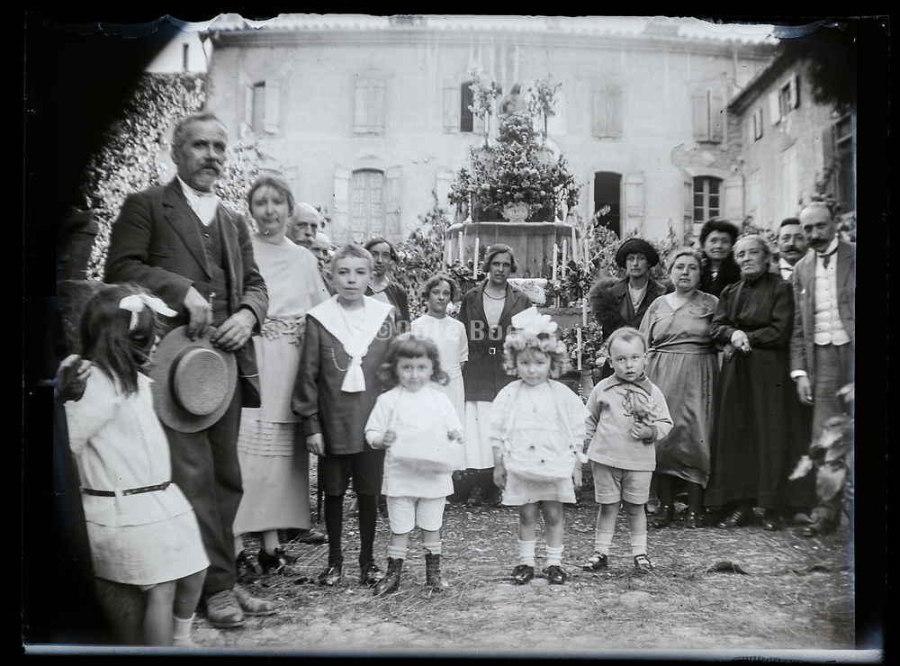 family standing by a decorated memorial  altar France 1923