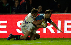Harlequins' Nick Evans scores his side's second try during the Aviva Premiership match at Twickenham Stoop, London.