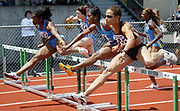 Perdita Felicien of Canada (left) leads Lacena Golding-Clark of Jamaica (center) and Joanna Hayes of the U.S. in the women's 100-meter hurdles  in the 31st Prefontaine Classic, Saturday, June 4, 2005, in Eugene, Ore. Felicien wins in 12.58 and Hayes places second in 12.72. Golding-Clark places fourth in 12.78.