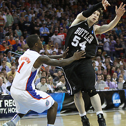 Mar 26, 2011; New Orleans, LA; Butler Bulldogs forward Matt Howard (54) passes off the ball as Florida Gators guard Kenny Boynton (1) defends during overtime in the semifinals of the southeast regional of the 2011 NCAA men's basketball tournament at New Orleans Arena. Butler defeated Florida 74-71.  Mandatory Credit: Derick E. Hingle