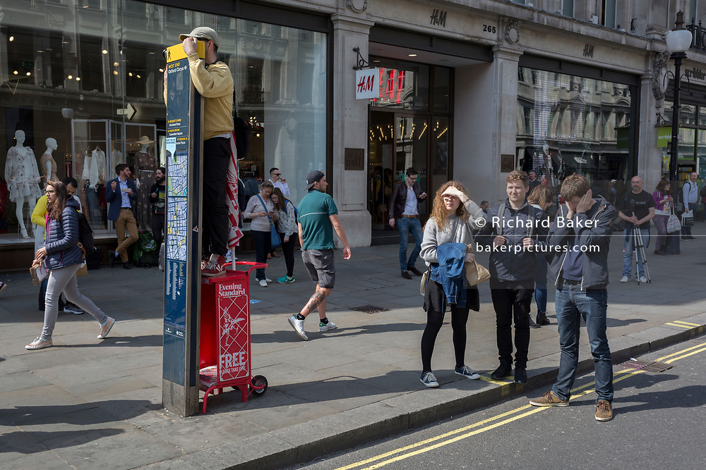 An onlooker watches arrests from a high lookout position at Oxford Circus on day 4 of protests by climate change environmental activists with pressure group Extinction Rebellion, on18th April 2019, in London, England.