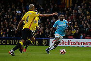 Burton Albion midfielder Lloyd Dyer (11) attacks forwards whilst Watford defender Younes Kaboul (4) defends during the The FA Cup 3rd round match between Watford and Burton Albion at Vicarage Road, Watford, England on 7 January 2017. Photo by Richard Holmes.