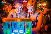 26 MAY 2007 -- People breathe in oxygen at the 02 Zone oxygen bar at the Fetish Prom at the Venue Nightclub in Scottsdale Saturday night. About 1,200 people, many members of the pangender, pansexual and panfetish community attended the event. PHOTO BY JACK KURTZ