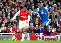 Photo: Ed Godden.<br />Arsenal v Portsmouth. The Barclays Premiership. 16/12/2006. Arsenal's Theo Walcott (L), strides away from Noe Pamarot.