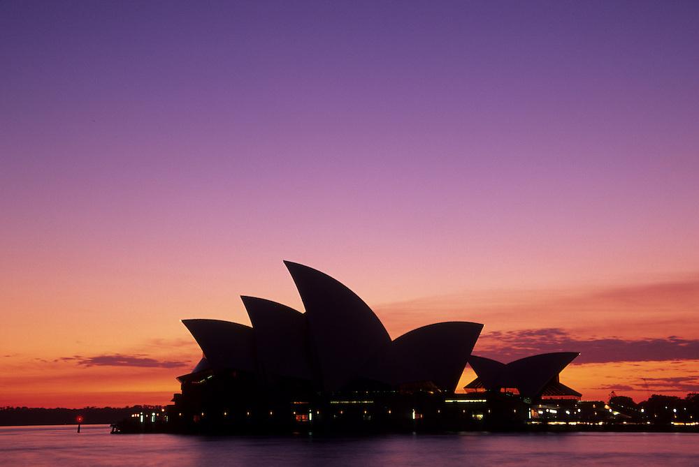 Australia, New South Wales, Sydney, Sydney Opera House (built 1973) and Sydney Harboar at sunset