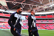 AFC Wimbledon striker Andy Barcham (17) and AFC Wimbledon defender Barry Fuller (2) walking onto pitch during the The FA Cup 3rd round match between Tottenham Hotspur and AFC Wimbledon at Wembley Stadium, London, England on 7 January 2018. Photo by Matthew Redman.
