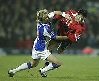 Photo: Aidan Ellis.<br /> Blackburn v Manchester United. Barclays Premiership. 01/02/2006.<br /> Blackburn's Michael Gray brings down United's Cristiano Ronaldo
