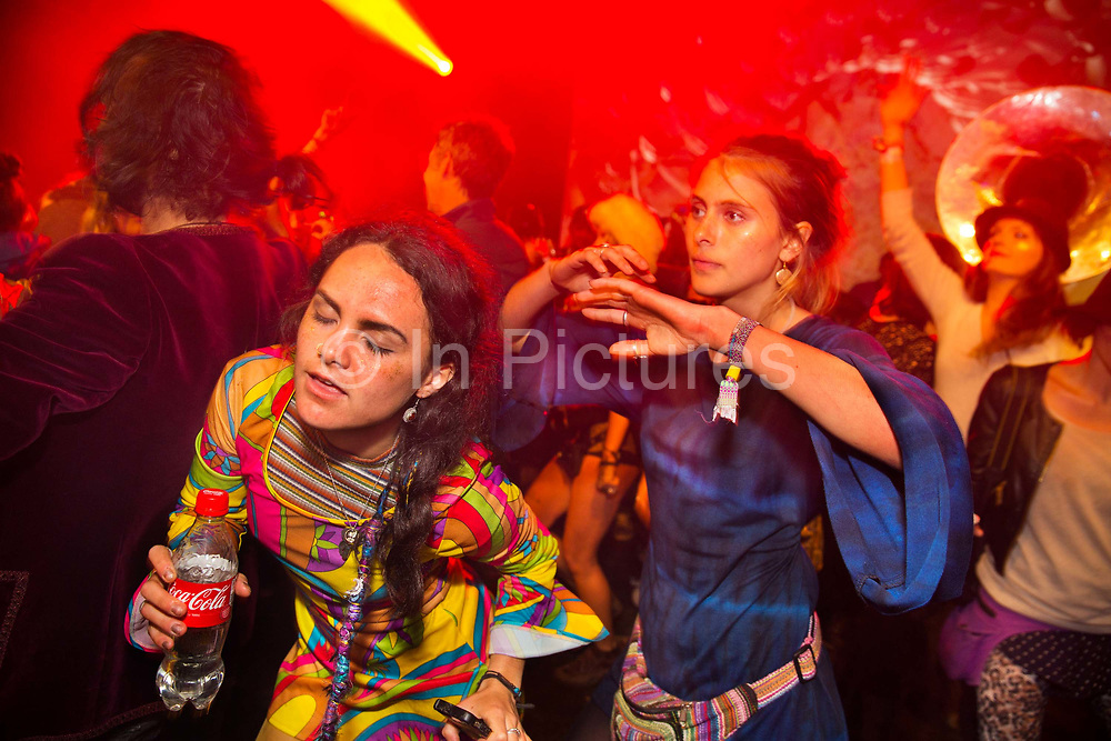 Glastonbury Festival, 2015. Shangri La is a festival of contemporary performing arts held each year within Glastonbury Festival. The theme for the 2015 Shangri La was Protest. Girls dancing on the Hell stage.