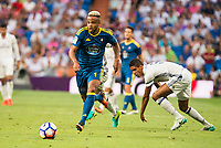 Real Madrid's player Raphael Varane and Celta de Vigo's player Theo Bongonda during a match of La Liga Santander at Santiago Bernabeu Stadium in Madrid. August 27, Spain. 2016. (ALTERPHOTOS/BorjaB.Hojas)