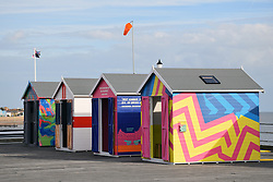 Brightly coloured beach huts on Southend pier as part of the Estuary Festival, Essex Sep 2016