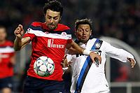 FOOTBALL - UEFA CHAMPIONS LEAGUE 2011/2012 - GROUP STAGE - GROUP B - LILLE OSC v INTER MILAN - 18/10/2011 - PHOTO CHRISTOPHE ELISE / DPPI - MARKO BASA (LOSC), MAURO ZARATE (INTER MILAN)