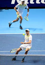 Bob Bryan and Mike Bryan (front) in action during their doubles match during day four of the NITTO ATP World Tour Finals at the O2 Arena, London.