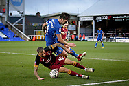 Peterborough United midfielder Alex Woodyard (4) is fouled by Bradford City forward David Ball (40) during  the The FA Cup 2nd round match between Peterborough United and Bradford City at London Road, Peterborough, England on 1 December 2018.