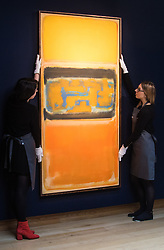 Christie's, London, March 3rd 2017. PICTURED: Gallery staff straighten Mark Rothko's 'No.1', painted in 1949, which is expected to fetch between £8-12 million.<br /> Fine art auctioneers Christies hold a press preview for their Post-War and Contemporary Art auctions to be held on March 7th and 8th.