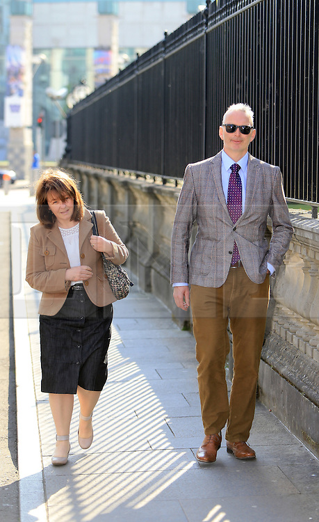 """© Licensed to London News Pictures. 9/05/2016. Belfast, Northern Ireland, UK. Karen and Colin McArthur (parents of Daniel McArthur) arrive at Belfast High Court for the start of an appeal hearing over gay marriage cake row with Ashers Baking Company. The legal appeal by Ashers Baking Company in the controversial 'gay cake' case is to be heard over two days. In May last year a judge at Belfast County Court ruled that the bakery had acted unlawfully. The court ordered Ashers to pay £500 damages after Judge Isobel Brownlie said the customer had been treated """"less favourably"""" contrary to the law and the bakery had breached political and sexual orientation discrimination regulations. But the McArthur family who own and run Ashers decided to challenge the ruling following consultations with their legal advisors. The family has been given the full support of The Christian Institute, which has funded their defence costs. The legal case followed a decision in May 2014 by Ashers to decline an order placed at its Belfast store by a gay rights activist who asked for a cake featuring the Sesame Street puppets, Bert and Ernie, and the campaign slogan, 'Support Gay Marriage'. The customer also wanted the cake to feature the logo of a Belfast-based campaign group QueerSpace. Ashers, owned by Colin and Karen McArthur, refused to make the cake because it carried a message contrary to the family's firmly-held Christian beliefs. They were supported by their son Daniel, the General Manager of the company. But the Equality Commission for Northern Ireland (ECNI) launched a civil action against the family-run bakery, claiming its actions violated equality laws in Northern Ireland and alleging discrimination under two anti-discrimination statutes – The Equality Act (Sexual Orientation) Regulations (NI) 2006 and The Fair Employment and Treatment (NI) Order 1998. Photo credit : Paul McErlane/LNP"""