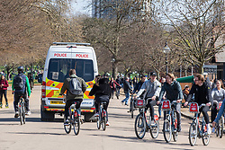 """© Licensed to London News Pictures. 02/04/2021. London, UK. Police patrol Hyde Park, London enforcing the """"Rule of Six"""" as members of the public go out on the first bank holiday of the Easter weekend as Prime Minister Boris Johnson urges the public not to break the remaining Covid-19 restrictions. Photo credit: Alex Lentati/LNP"""