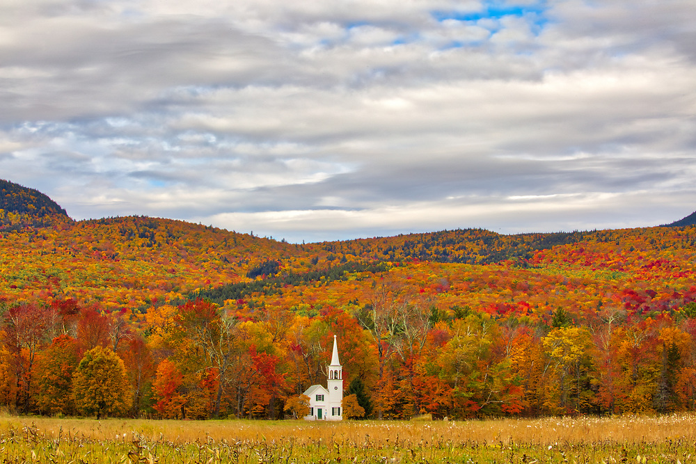 New England fall foliage peak colors framing the iconic Wonalancet Union Church in Tamworth, New Hampshire. It was my first visit and approaching the location just blew me away. I quickly pulled over and explored certain perspectives and in this image made my way into the field with a wide angle lens. I loved how this classic New England Photography subject was framed by the colorful autumn foliage. <br /> <br /> New Hampshire White Mountains fall foliage photography images of the Wonalancet Union Church available as museum quality photo, canvas, acrylic, wood or metal prints. Wall art prints may be framed and matted to the individual liking and interior design decoration needs:<br /> <br /> https://juergen-roth.pixels.com/featured/new-hampshire-fall-foliage-framing-the-wonalancet-union-church-juergen-roth.html<br /> <br /> Contact Juergen directly for photo wall art murals.<br /> <br /> Good light and happy photo making!<br /> <br /> My best,<br /> <br /> Juergen<br /> Photo Prints: http://www.rothgalleries.com<br /> Photo Blog: http://whereintheworldisjuergen.blogspot.com<br /> Instagram: https://www.instagram.com/rothgalleries<br /> Twitter: https://twitter.com/naturefineart<br /> Facebook: https://www.facebook.com/naturefineart