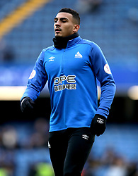 Huddersfield Town's Karlan Grant warms up on the pitch prior to the Premier League match at Stamford Bridge, London.