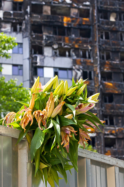 9 July 2017 taken between the hours of 14.43 - 15.28<br /> <br /> The Grenfell Tower fire occurred on 14 June 2017 at the 24-storey, 220-foot-high (67 m), Grenfell Tower block of public housing flats in North Kensington, Royal Borough of Kensington and Chelsea, West London. It caused at least 80 deaths and over 70 injuries. A definitive death toll is not expected until at least 2018. As of 5 July 2017, 21 victims had been formally identified by the Metropolitan Police. Authorities were unable to trace any surviving occupants of 23 of the flats.<br /> <br /> Emergency services received the first report of the fire at 00:54 local time. It burned for about 60 hours until finally extinguished. More than 200 firefighters and 45 fire engines from stations all over London were involved in efforts to control the fire. Many firefighters continued to fight pockets of fire on the higher floors after most of the rest of the building had been gutted. Residents of surrounding buildings were evacuated due to concerns that the tower could collapse, but the building was later determined to be structurally sound.<br /> <br /> The tower contained 129 flats. Police were unable to trace any survivors from 23 of these, and their occupants are believed to have died in the fire. Firefighters rescued 65 people. Seventy-four people were confirmed to be in six hospitals across London, and 17 of them were in a critical condition. The fire started in a fridge-freezer on the fourth floor. The growth of the fire is believed to have been accelerated by the building's exterior cladding.  ( Source Wikipedia}