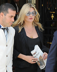 kate moss seen leaving the ritz hotel in paris holding a copy of todays new york times<br />