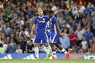 Michy Batshuayi of Chelsea ® celebrates after scoring his sides 1st goal of the match to make it 1-0 with Branislav Ivanovic of Chelsea. EFL Cup 2nd round match, Chelsea v Bristol Rovers at Stamford Bridge in London on Tuesday 23rd August 2016.<br /> pic by John Patrick Fletcher, Andrew Orchard sports photography.