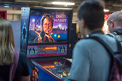 © Licensed to London News Pictures. 12/08/2018. LONDON, UK. People play pinball machines at Play Expo London, a video games show featuring consoles, handhelds, computers, vintage arcades and pinball machines, organised by Replay Events taking place at the Printworks in Canada Water, East London.  Photo credit: Stephen Chung/LNP